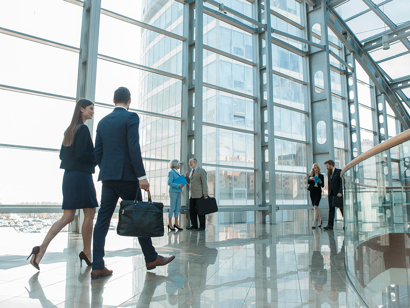 Businesspeople walking in modern office space