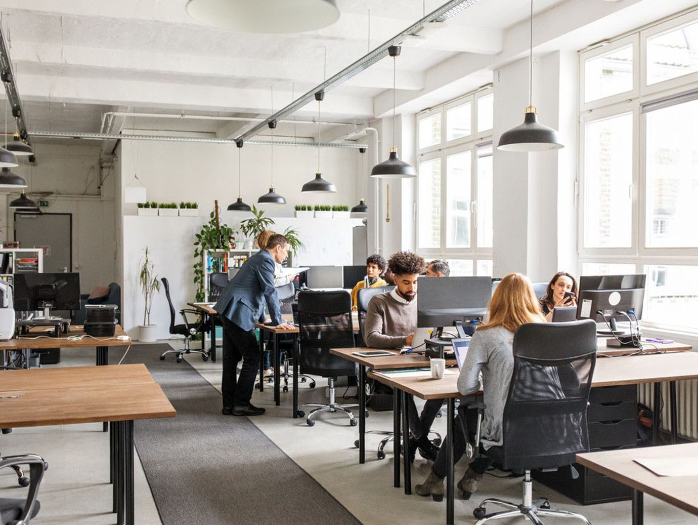 Businesspeople working in modern office space