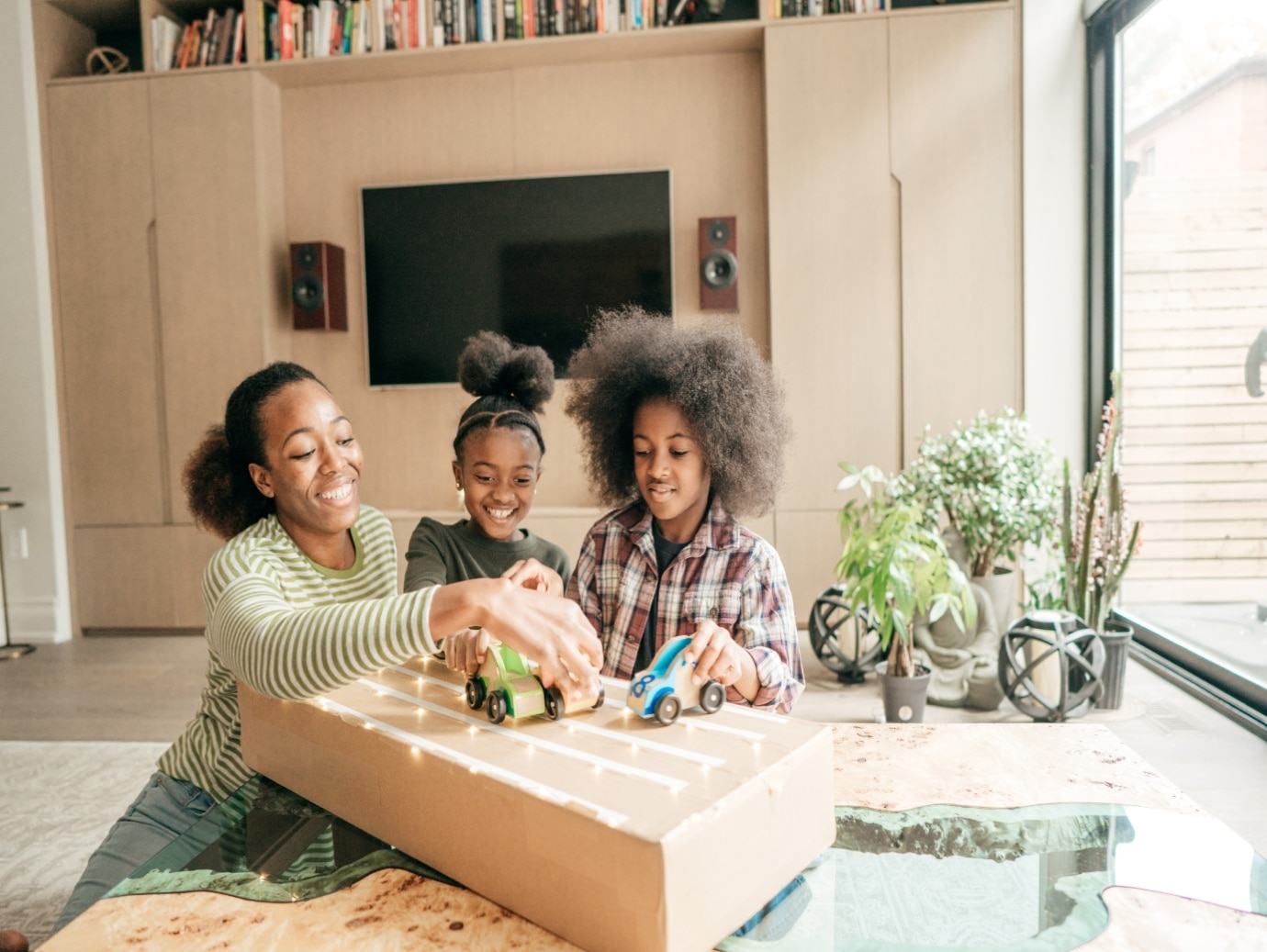 Home uses a YORK Packaged Unit to keep family comfortable while mother plays with her two daughters in the living room.
